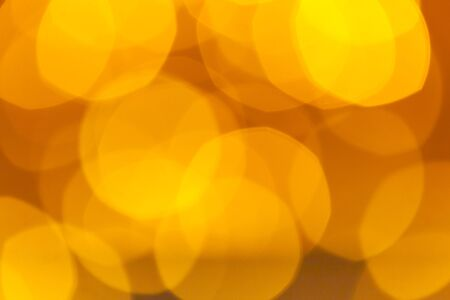 Abstract Orange Bokeh with blurred background nature blurry light party in vintage style warm shimmering. Festive lights bokeh. Stockfoto