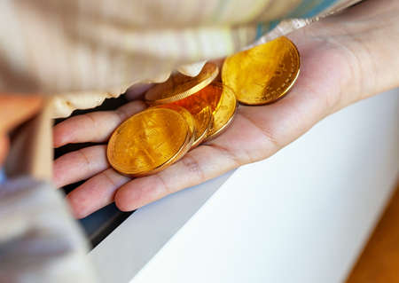Bitcoin coins hidden under the mattress. Concept of BTC cryptocurrency as a source of savings.
