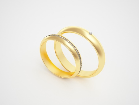 Golden rings with diamonds - friendships - marriage - weddingrings - pair Stock Photo - 10784981