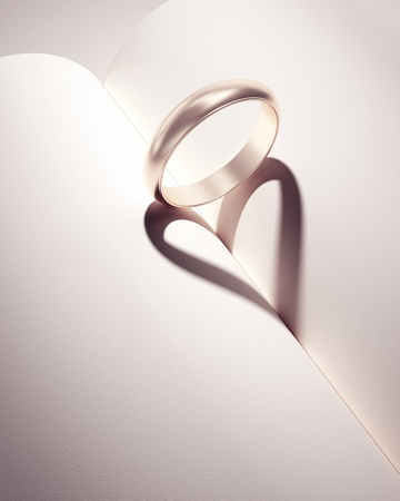 heartshadow with rings on a book middle - card - write your text in white space Stock Photo - 10785023