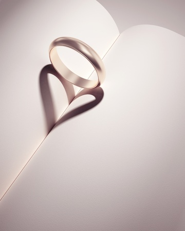 ring wedding: heartshadow with rings on a book middle - card - write your text in white space