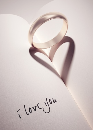 heartshadow with rings on a book middle - i love you - card