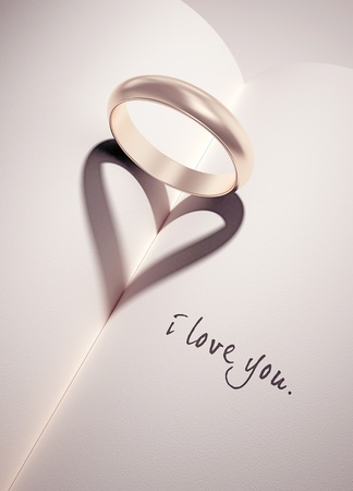 heartshadow with rings on a book middle - i love you - card Stock Photo - 10785021