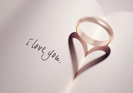 liefde: heartshadow met ringen aan een boek midden - i love you - kaart