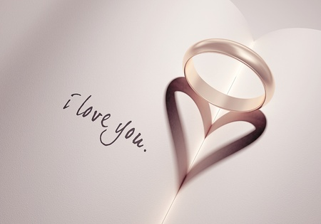 proposals: heartshadow with rings on a book middle - i love you - card