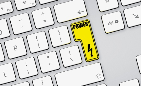 power suppliers: yellow power flash button on white keyboard Stock Photo