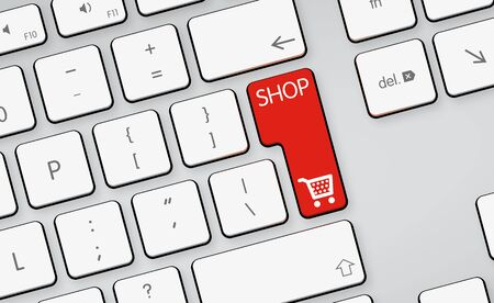 Red shopping button on white keyboard Stock Photo
