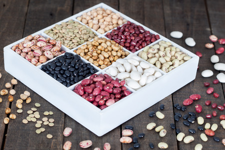 lima beans white beans: Sources of protein: lentils, beans, kidney beans, chickpeas on wooden table Stock Photo