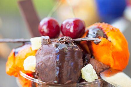 Chocolate and cherry ice cream with caramel sauce Stock Photo