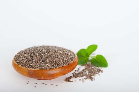 Healthy chia seeds (lat. Salvia hispanica) in wooden bowl. Vegan diet concept