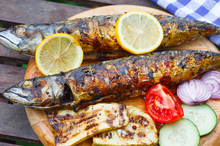 Grilled sea mackerel fish. Omega 3 fats. Outdoor picnic Stock Photo