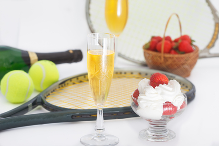 Strawberries and champagne with tennis equipment on Wimbledon tournament. Wimbledon Grand slam celebration concept. 写真素材