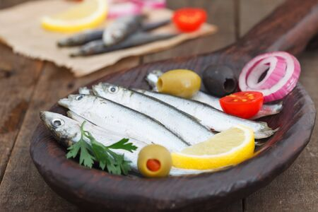 Salted sardines in wooden plate. Appetizer meal. Healthy Sea food full of omega3 fat. 写真素材
