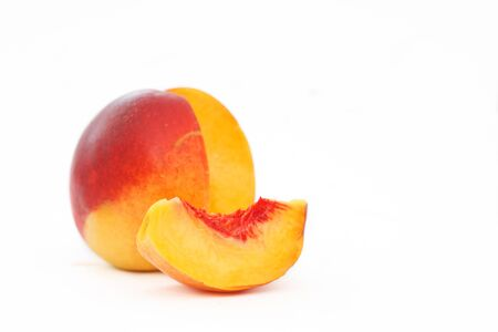Delicious and juicy nectarina peach isolated on white background. Healthy summer fruit.