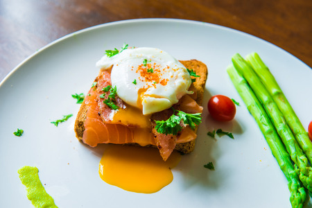 Sandwich with poached egg, parma ham and Salmon Stock Photo