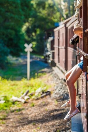Girl sitting on the edge of the train
