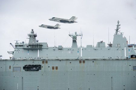 Aircrafts lifting off from an amphibious transport dock