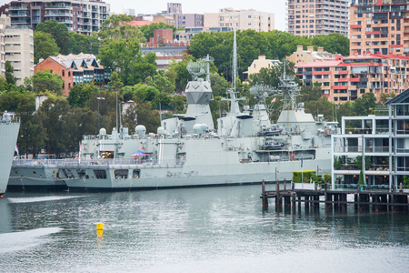 Military warship near a town Banque d'images
