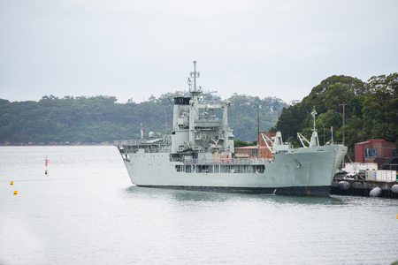 Military warship by a dock Banque d'images