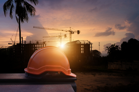 Safety helmet silhouette construction site at Thailand in sunset time.