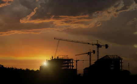 Silhouette construction site with beautiful sunset sky background. Abandon building with sunset background. Standard-Bild - 123913908