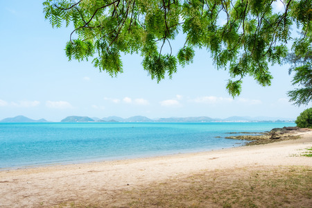 Sea view from tropical beach with sunny sky. Tropical shore. Tropical sea in Thailand. Ocean beach relax, outdoor travel. Standard-Bild