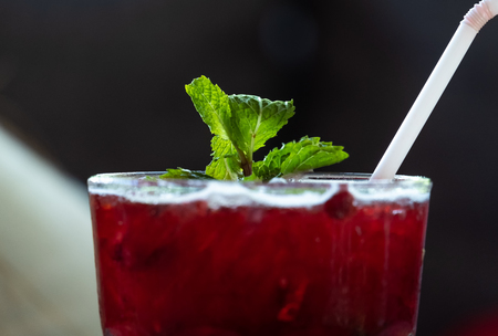 Fresh red juices, sweet and sour taste, placed on a blurred background. Standard-Bild