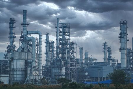 Petrochemical industry on sunset and Twilight sky, Power plant, Energy power station area.