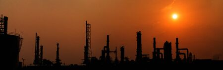 Silhouette petrochemical industry area. Petrochemical industry on sunset and Twilight sky, Energy power station area.