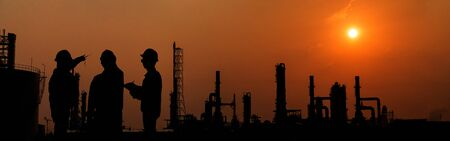 Silhouette engineer working in Petrochemical industry area. Petrochemical industry on sunset and Twilight sky, Energy power station area. Petrochemical industry with worker or engineer.