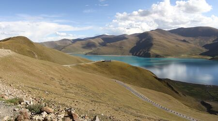 foothills of the Tibetan landscape with river and mountains