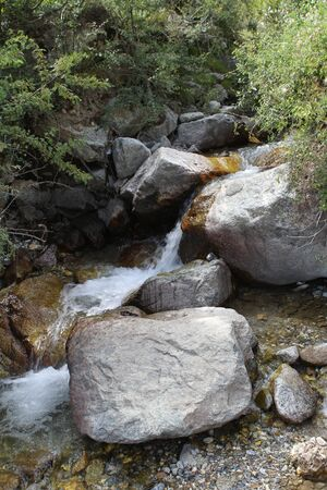 a small mountain river in the foothills of Tibet, China