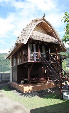equator: tropical cottage with a thatched roof, Bali, Indonesia, the equator