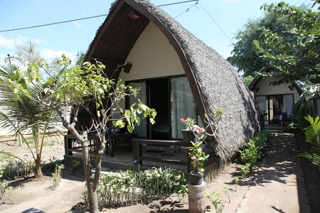equator: Tropical cottage with a thatched roof, Gili Islands, Indonesia, the equator