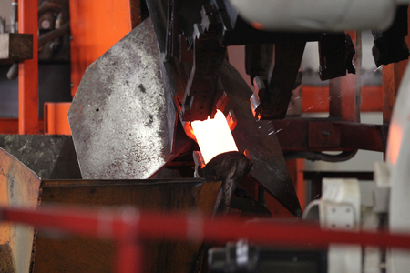 positioning: positioning unit and supplying the heated round billet