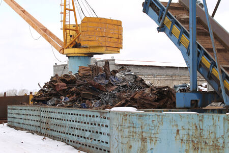 scrap metal: Playground for processing scrap metal with an elevator and crane Stock Photo