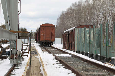 prospect: the prospect of old rail cars on a railway track stock