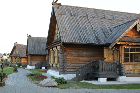 pastiche: Modern architectural pastiche traditional Russian wooden hut with wooden roof