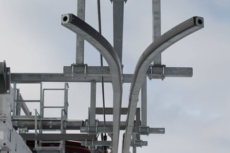 metal structure: elements of metal structures ski lift against the sky