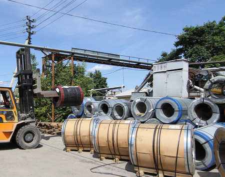 coils: view of the storage of steel coils with a loader for loading and unloading