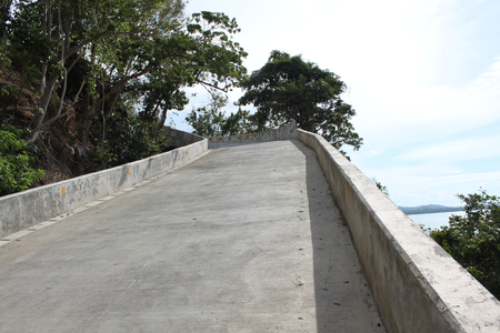 tilt views: concrete road with large borders goes up Stock Photo