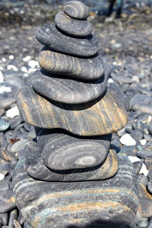 steadiness: Pyramid of stacked stones at the beach, Thailand