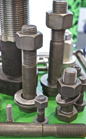 fasteners: Set of hardware products with thread, fasteners Stock Photo
