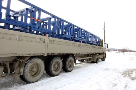 autotruck: truck loaded with metal structures on the industrial site