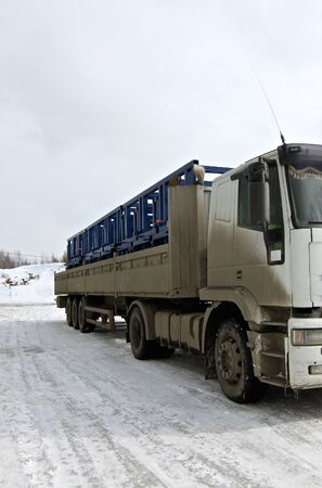 metal structure: truck loaded with metal structures on the industrial site