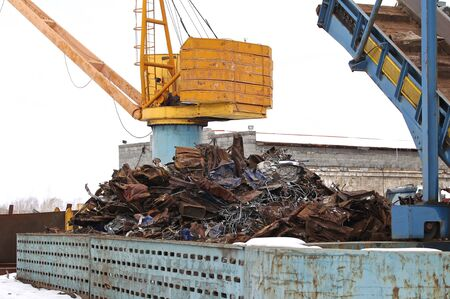 scrap metal: crane to move the scrap metal and other materials Stock Photo