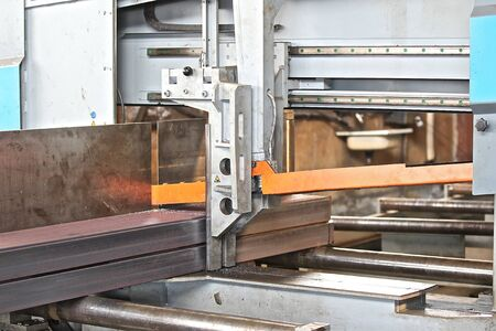 rolled: powerful industrial band saw for cutting of long rolled metal Stock Photo
