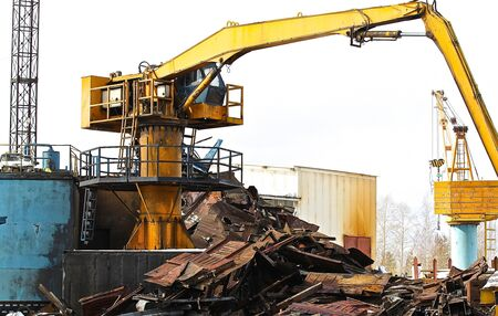altmetall: crane to move the scrap metal and other materials Editorial