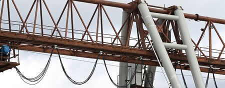 type of bearing metal structures of gantry crane against the blue sky Stock Photo