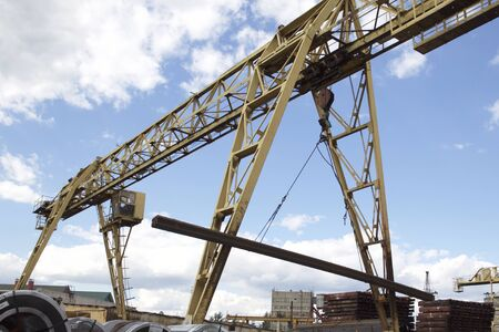 Metal construction of the crane, against the sky, in the warehouse, Russia Stock Photo